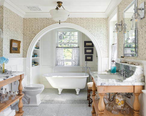 """<p>Historic heirlooms and glorious collections fill nearly every corner in the <a href=""""https://www.veranda.com/home-decorators/a27651886/philip-mitchell-seaside-cottage/"""">18th-century Nova Scotia cottage</a> of designer <a href=""""https://philipmitchelldesign.com/"""">Philip Mitchell</a>, including the airy guest bath. The ivory trim and wall color frames a textured <a href=""""http://christopherfarrcloth.com/"""">Christopher Farr</a> wallcovering while becoming the perfect backdrop to display colorful pottery from local artist <a href=""""http://www.amicusgallery.ca/"""" target=""""_blank"""">Paula MacDonald</a>. A <a href=""""https://www.waterworks.com/"""" target=""""_blank"""">Waterworks</a> claw-foot tub sits in the small nook with <a href=""""https://www.chelseatextiles.com/us/"""" target=""""_blank"""">Chelsea Textiles</a> window curtains. The trim and walls are painted <a href=""""https://www.benjaminmoore.com/en-us/color-overview/find-your-color/color/968/dune-white?color=968"""" target=""""_blank"""">Dune White</a> by <a href=""""https://www.benjaminmoore.com/en-us"""" target=""""_blank"""">Benjamin Moore</a>.</p>"""