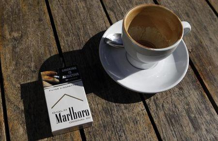 A Marlboro cigarettes pack, a brand of Philip Morris Tobacco, lies next to an empty coffee cup at a cafe in central Sydney