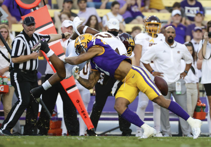LSU cornerback Derek Stingley Jr. (7) forces a fumble by Central Michigan running back Darius Bracy (2) during the first quarter of an NCAA college football game in Baton Rouge, La,. Saturday, Sept. 18, 2021. (AP Photo/Derick Hingle)