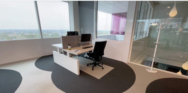 Cushman & Wakefield 6 Feet Office design - circles on the floor delineate safe social distancing parameters