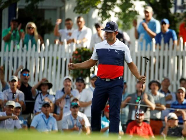 Woodland feels at home in Missouri, leads PGA with 64