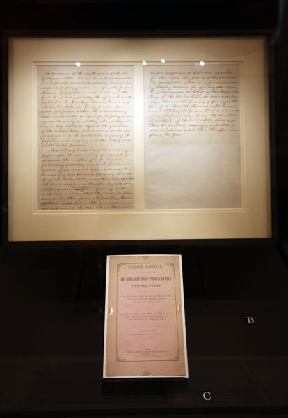 """FILE - This Feb. 9, 2009 file photo shows the first draft of President Abraham Lincoln's Emancipation Proclamation that Lincoln presented to his full cabinet on July 22, 1862, displayed at the Library of Congress in Washington. As New Year's Day approached 150 years ago, all eyes were on President Abraham Lincoln in expectation of what he warned 100 days earlier would be coming _ his final proclamation declaring all slaves in states rebelling against the Union to be """"forever free.""""A tradition began on Dec. 31, 1862, as many black churches held Watch Night services, awaiting word that Lincoln's Emancipation Proclamation would take effect as the country was in the midst of a bloody Civil War. Later, congregations listened as the president's historic words were read aloud. (AP Photo/Pablo Martinez Monsivais, File)"""