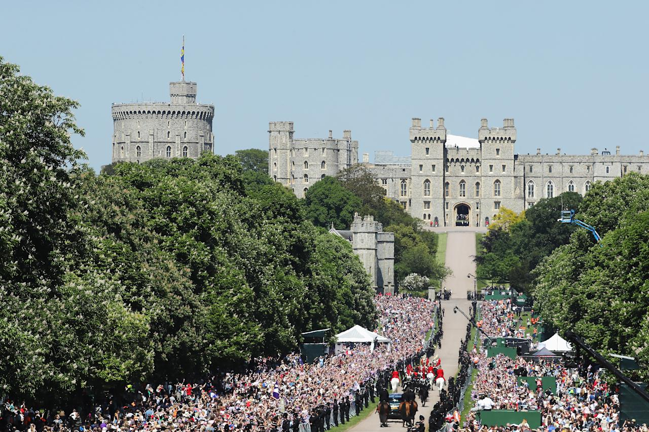 <p>Standing room only: Windsor Castle stands in the background in tbhe glorious May sunshine as the big moment approaches. (Getty) </p>