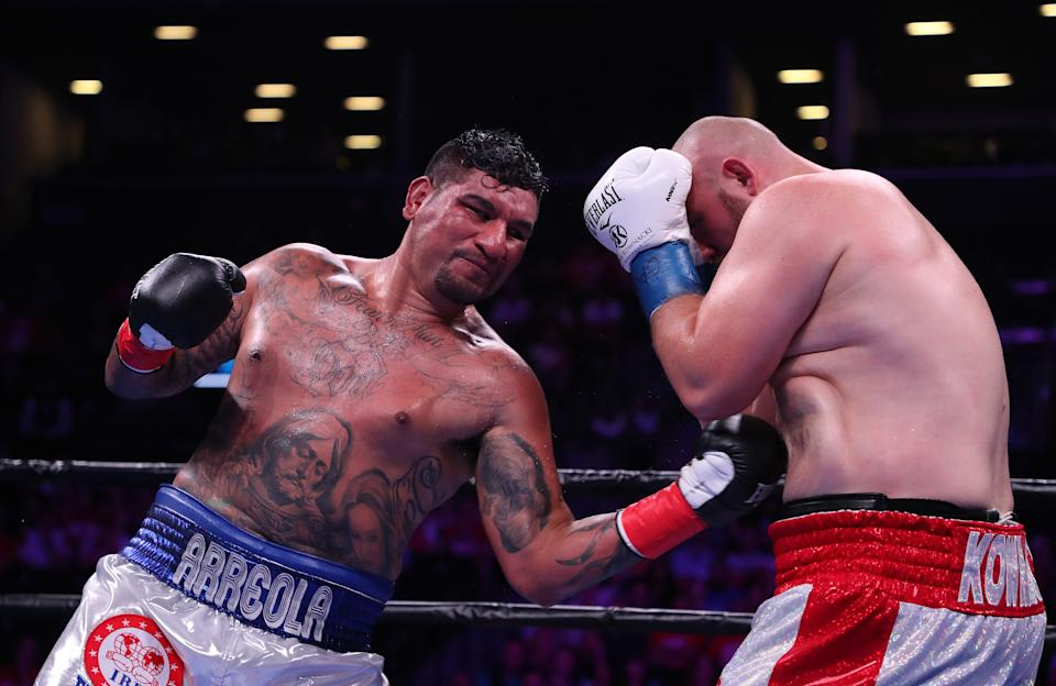NEW YORK, NEW YORK - AUGUST 03: Chris Arreola punches Adam Kownacki during their heavyweight fight at Barclays Center on August 03, 2019 in New York City. (Photo by Al Bello/Getty Images)