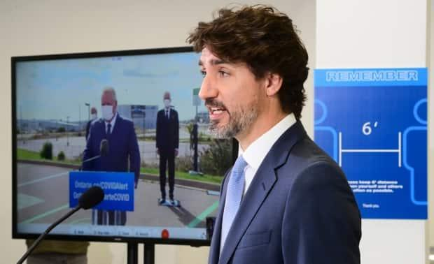 Prime Minister Justin Trudeau takes part in a press conference with Ontario Premier Doug Ford (on screen) Oct. 8 2020. Trudeau is under pressure to boost health funding to the provinces. (Sean Kilpatrick/The Canadian Press - image credit)