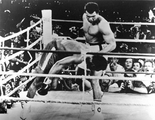 "<p>ZAIRE,AFRICA – OCTOBER 30,1974: Muhammad Ali lands a left hook knocking out George Foreman during the ""Rumble in the Jungle"" fight at the Mai 20 Stadium on October 30,1974 in Kinshasa,Zaire. Muhammad Ali won WBC heavyweight title and the WBA World heavyweight title W KO 8. (Photo by: The Ring Magazine/Getty Images)</p>"