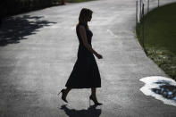 First Lady Melania Trump walks to meet President Donald Trump before boarding Marine One from the South Lawn of the White House on August 7, 2019 in Washington, DC. (Photo by Oliver Contreras/SIPA USA)