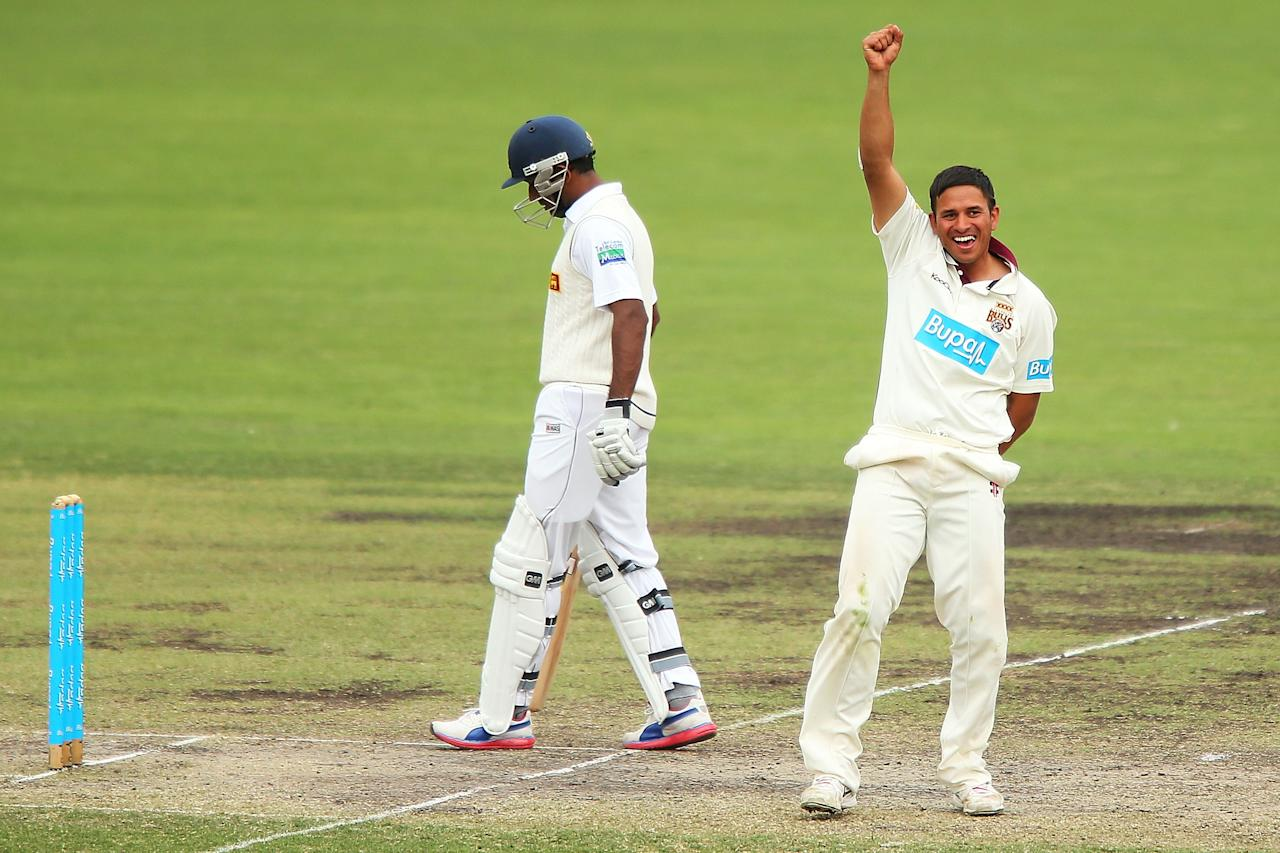 CANBERRA, AUSTRALIA - DECEMBER 07:  Usman Khawaja of the Chairman's XI celebrates after claiming the wicket of Kumar Sangakkara of Sri Lanka during day two of the international tour match between the Chairman's XI and Sri Lanka at Manuka Oval on December 7, 2012 in Canberra, Australia.  (Photo by Brendon Thorne/Getty Images)