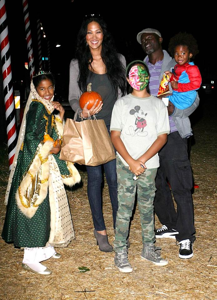 Kimora Lee Simmons and her hubby Djimon Hounsou took a night trip to the trendy Mr. Bones Pumpkin Patch in West Hollywood, California, with their family, which includes Kimora's daughters Ming Lee and Aoki Lee from her marriage to Russell Simmons, as well as her son Kenzo Lee with Djimon. (10/23/2011)