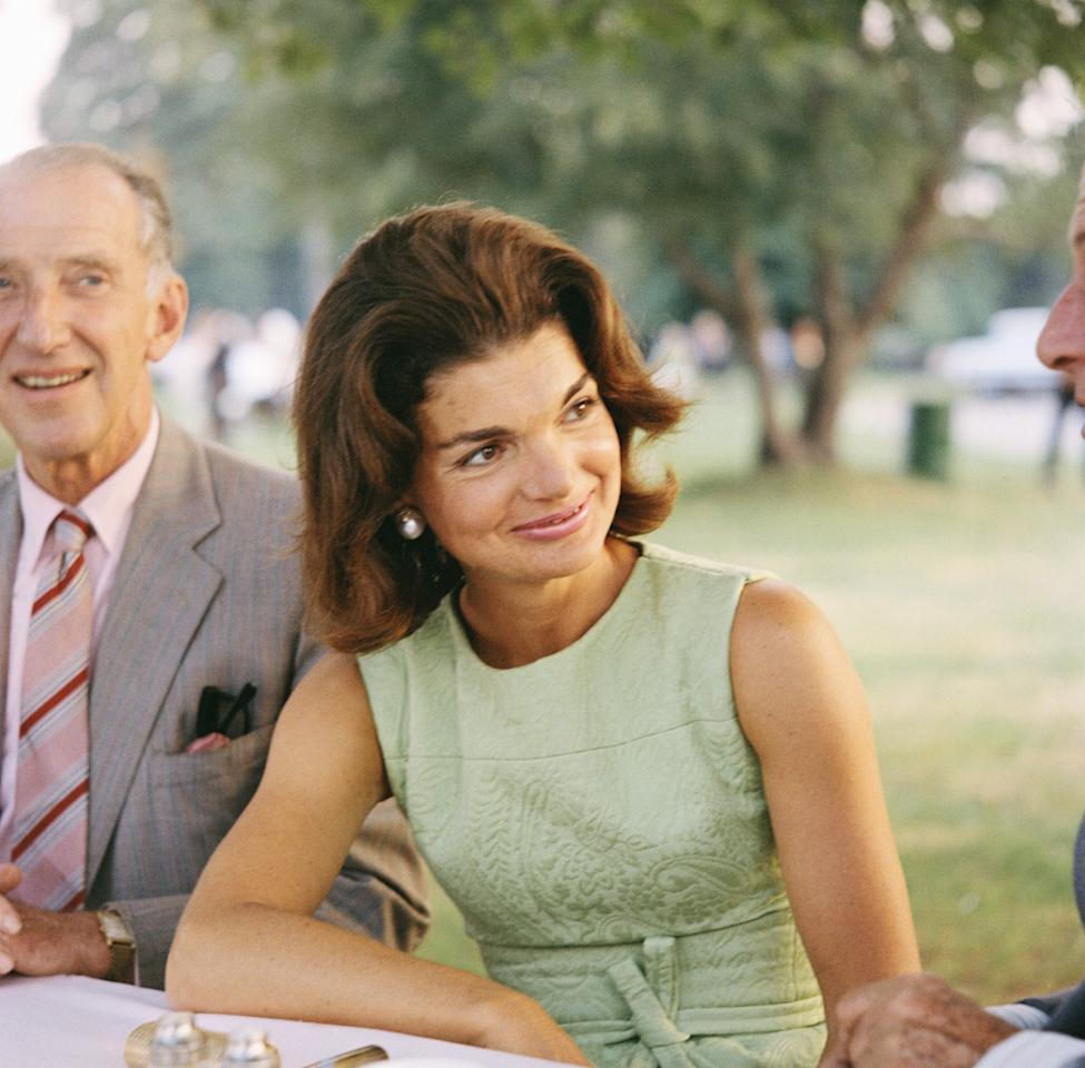 """<p>When Jaqueline Bouvier married John F. Kennedy in 1953, she became the other half of a society couple that was envied and idolized the world over. Soft-spoken and supremely stylish, Jackie first earned international fame as her husband's reluctant companion on the campaign trail. The two brought youth and optimism to the White House, but it was images of the First Lady and her young children bidding farewell to JFK after his tragic assassination that cemented the Kennedy legacy in history, making them iconic political and public figures for years to come. Beyond her life as a Kennedy, Jackie reinvented herself in her second marriage to Aristotle Onassis in 1968, and later embarked <a href=""""https://www.townandcountrymag.com/society/a10334726/jackie-kennedy-publishing-career/"""" target=""""_blank"""">on her second chapter as a book editor</a> in New York.<br></p><p>Now, 25 years after she passed away from Non-Hodgkin's lymphoma at age 64, we're taking a look back on the remarkable life of Jaqueline Kennedy Onassis.</p>"""