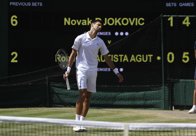 Serbia's Novak Djokovic reacts after losing a point to Spain's Roberto Bautista Agut in a Men's singles semifinal match on day eleven of the Wimbledon Tennis Championships in London, Friday, July 12, 2019. (AP Photo/Kirsty Wigglesworth)