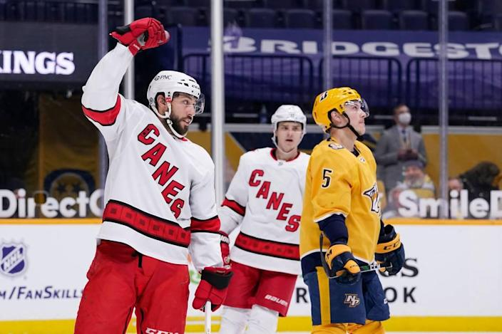 Carolina Hurricanes center Vincent Trocheck, left, celebrates after scoring a goal against the Nashville Predators in the first period of an NHL hockey game Tuesday, March 2, 2021, in Nashville, Tenn. (AP Photo/Mark Humphrey)