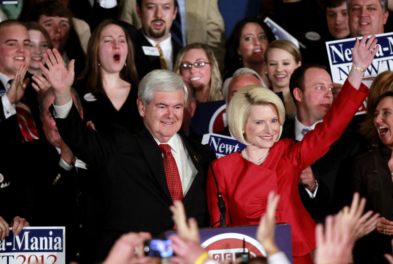 Republican presidential candidate former House Speaker Newt Gingrich and his wife Callista wave to supporters before speaking to a crowd gathered for a rally after he won the Georgia Republican primary Tuesday, March 6, 2012 in Atlanta. (AP Photo/John Bazemore)