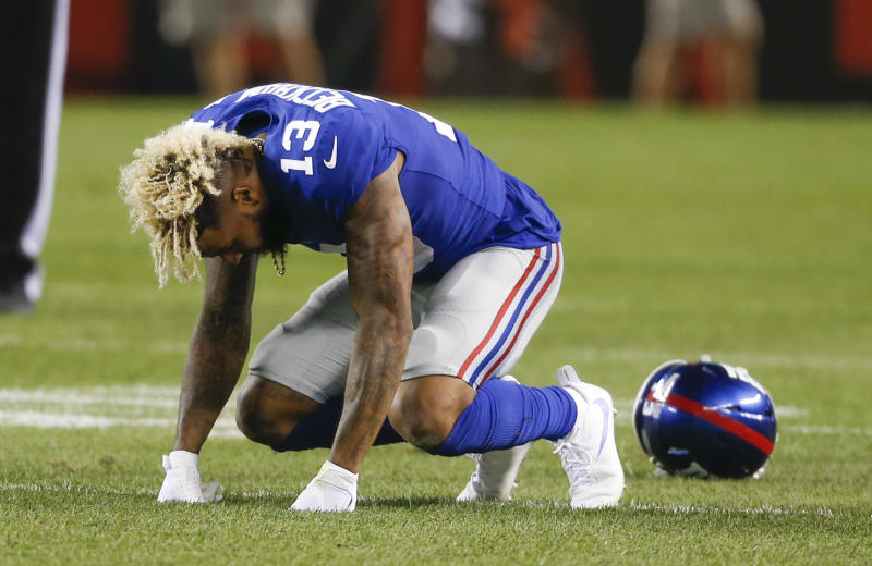 Odell Beckham Jr. suffered a scary hit, courtesy of the Browns' XXXX, on Monday night. He was diagnosed with only an ankle sprain. (Photos by AP)