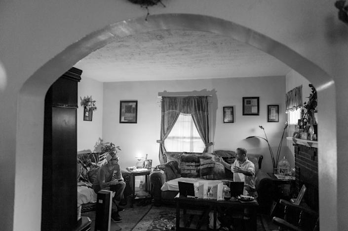 <p>Larry Fugate listens to his step-father Gene Robinson at their home in Middletown, Ohio. Both men are recovering heroin addicts.<br> (Photograph by Mary F. Calvert for Yahoo News) </p>