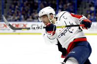 FILE - In this Dec. 14, 2019, file photo, Washington Capitals left wing Alex Ovechkin follows through on a shot against the Tampa Bay Lightning during the first period of an NHL hockey game in Tampa, Fla. Ovechkin starts a new five-year contract ready to chase Wayne Gretzky's career goals record that long seemed unbreakable. The Washington Capitals captain has 730 goals and needs 165 to pass Gretzky. (AP Photo/Chris O'Meara, File)