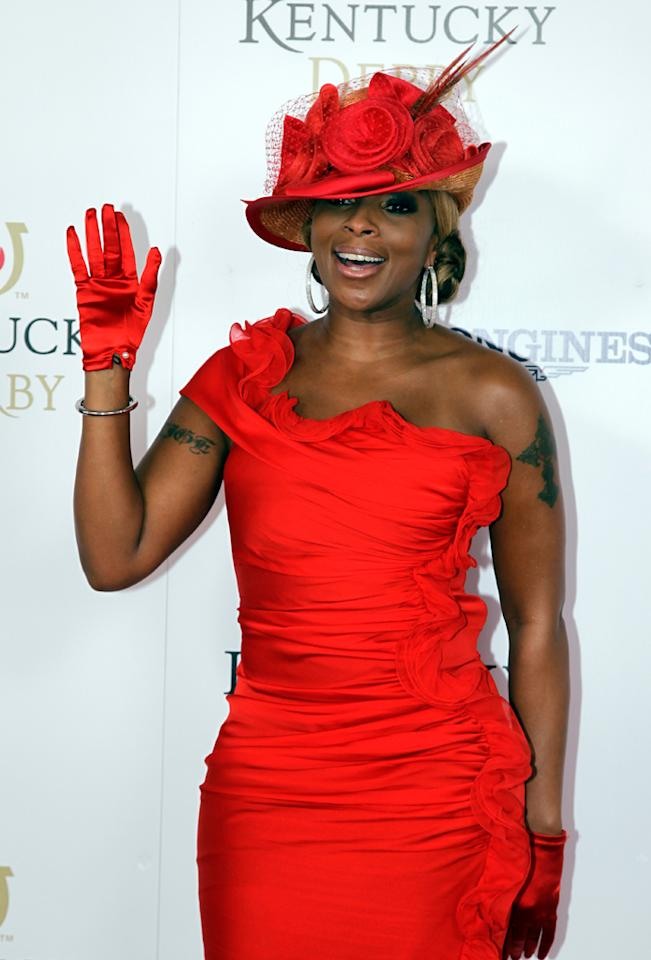 "<p class=""MsoNormal"">Mary J. Blige, who kicked the horse race off with soulful version of ""The Star-Spangled Banner,"" accessorized her red frock with matching gloves, a flower-adorned chapeau, and pretty Lorraine Schwartz diamond hoop earrings. <span style=""font-size:12.0pt;""></span>  </p><p class=""MsoNormal""></p>"