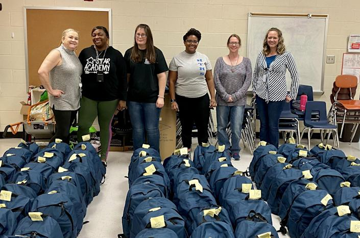 Volunteers from Pender County, North Carolina, churches stuff backpacks for students experiencing housing and food insecurity. (Pender County Christian Services)