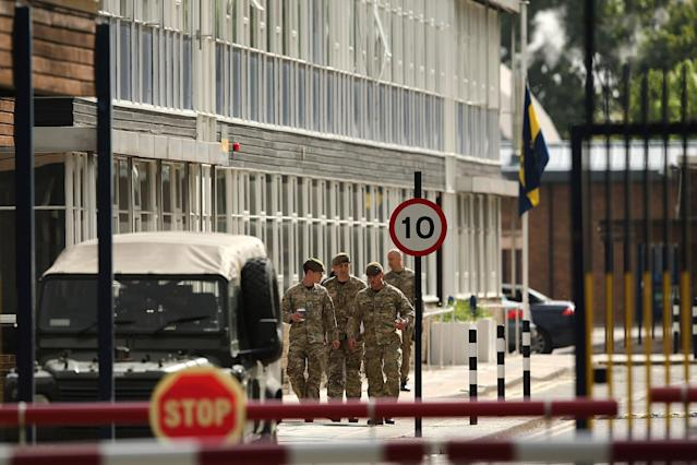 LONDON, ENGLAND - MAY 23: Soldiers walk past a flag which flies at half mast inside Woolwich Barracks on May 23, 2013 in London, England. A British soldier was murdered by suspected Islamists near London's Woolwich Army Barracks yesterday in a savage knife attack. British Prime Minister David Cameron has said that the 'appalling' attack appeared to be terror related. (Photo by Dan Kitwood/Getty Images)