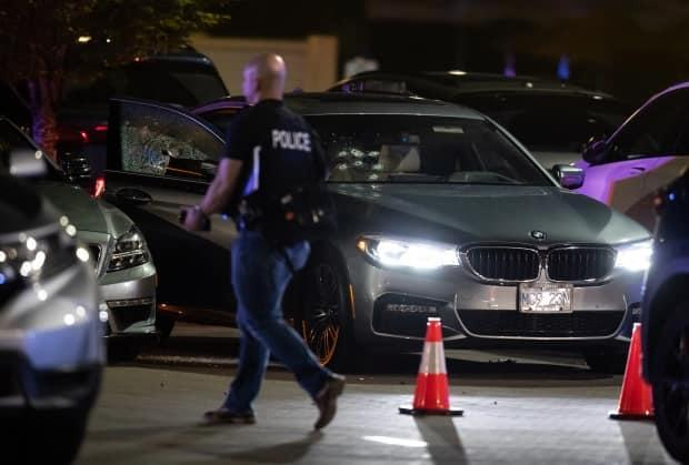 Bullet holes are seen in the windshield of a vehicle in the parking lot of a shopping complex after one person was killed and two others were injured during a shooting in Burnaby, B.C., on May 13, 2021.