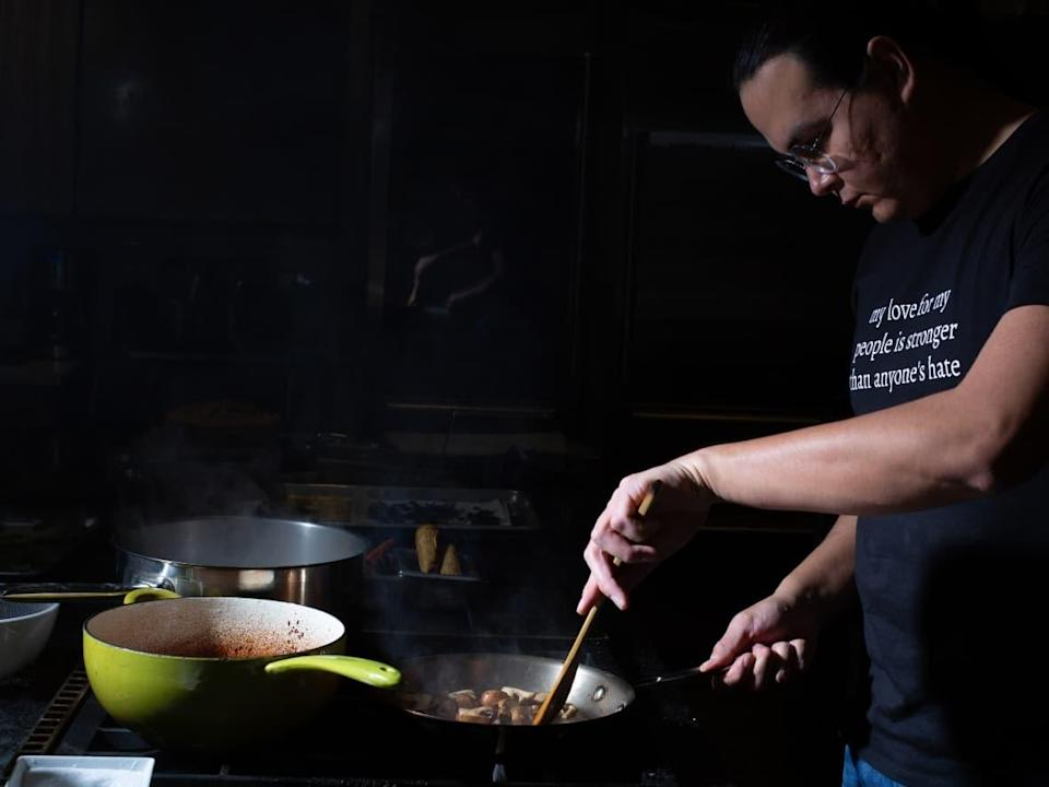 Scott Iserhoff, a Mushkegochef from Attawapiskat First Nation in Ontario, prepares Indigenous cuisine as part of his business, Pei Pei Chei Ow, in Edmonton. He offers guests the chance to learn about contemporary Indigenous food while also tasting bannock, stews and other dishes. (Submitted by Scott Iserhoff - image credit)
