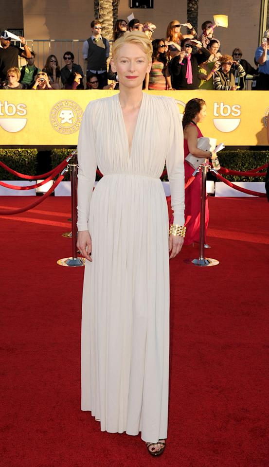 Tilda Swinton (in Lanvin) arrives at the 18th Annual Screen Actors Guild Awards at The Shrine Auditorium in Los Angeles, California.