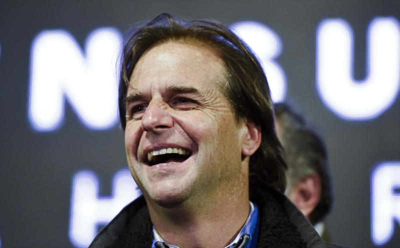 Presidential candidate Luis Lacalle Pou, leader of the opposition National Party, smiles before supporters during his campaign rally in San Jose, Uruguay, Tuesday, Oct. 22, 2019. Lacalle Pou, 47, is a longtime legislator with deep political roots, his father was president in the 1990s and his mother was a senator. He ran for president in 2014, losing to the current president in a runoff. (AP Photo/Matilde Campodonico)