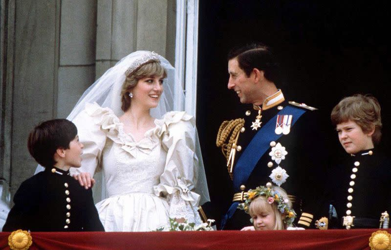 FILE PHOTO: Prince Charles and Princess Diana stand on the balcony of Buckingham Palace following their wedding at St. Pauls Cathedral