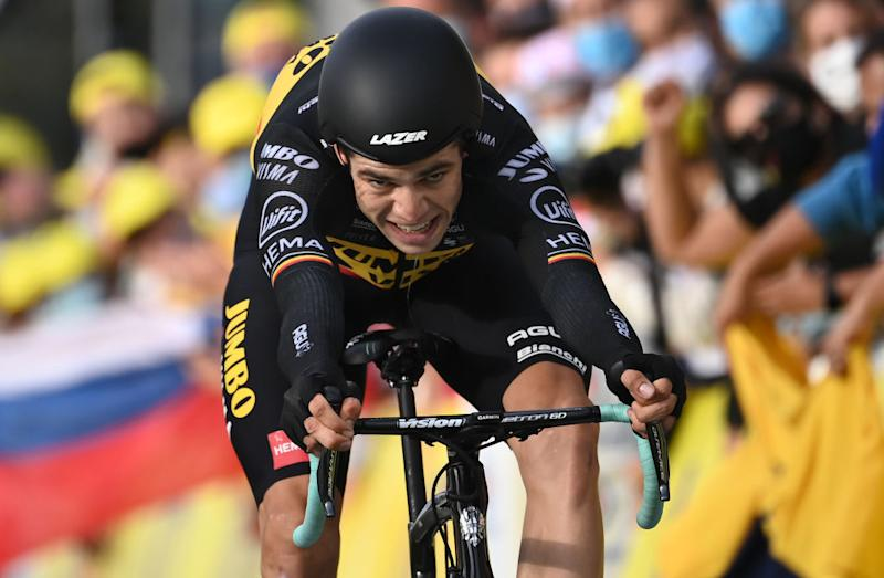 TOPSHOT Team Jumbo rider Belgiums Wout van Aert crosses the finish line at the end of the 20th stage of the 107th edition of the Tour de France cycling race a time trial of 36 km between Lure and La Planche des Belles Filles on September 19 2020 Photo by Marco BERTORELLO POOL AFP Photo by MARCO BERTORELLOPOOLAFP via Getty Images