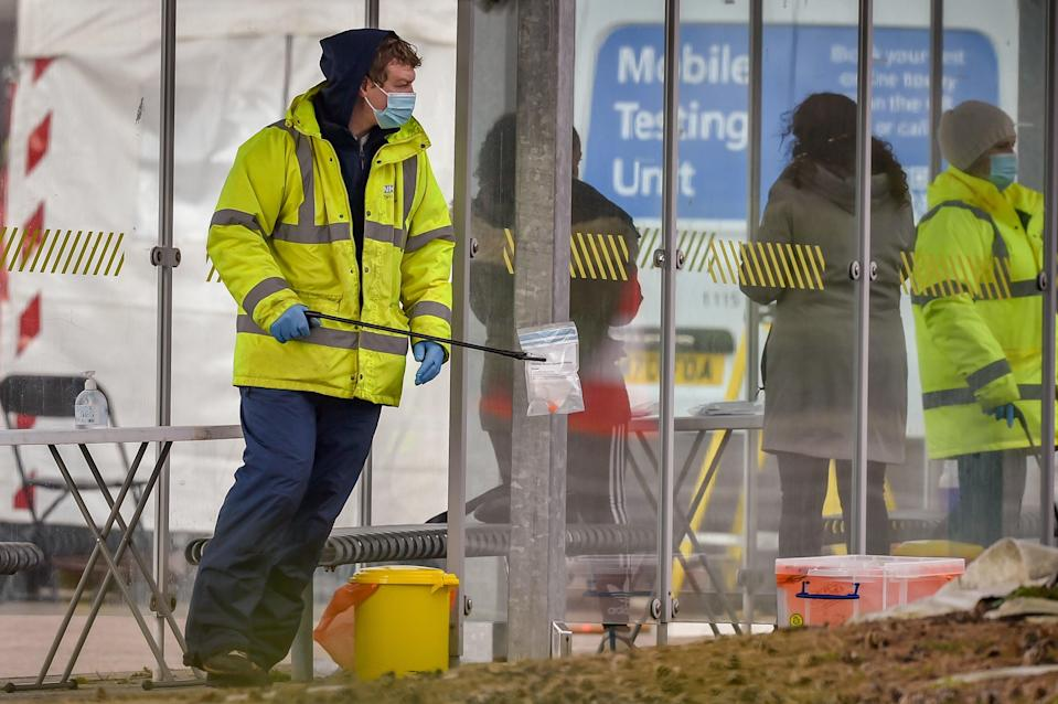 <p>Walk-in surge testing at The Mall in Cribbs Causeway, one of two sites in South Gloucestershire, after two cases of the Brazilian variant of coronavirus were identified in the area</p> (PA)
