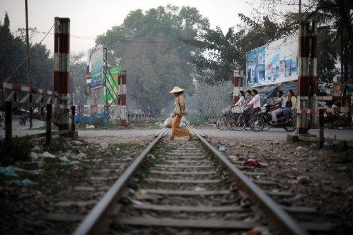 A woman crosses the railway tracks in Myitkyina, northern Kachin state. UN Secretary General Ban Ki-moon has called for an end to the bloodshed that has torn Kachin apart since a 17-year ceasefire was shattered last year