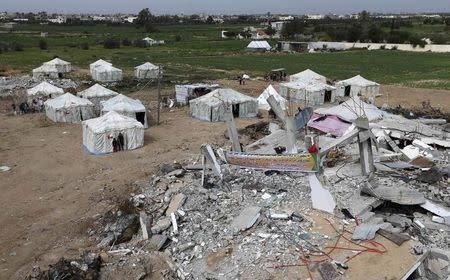 Tents erected by Palestinians near ruins of houses which witnesses said were destroyed by Israel shelling during 50-day conflict last summer, east of Khan Younis in Gaza