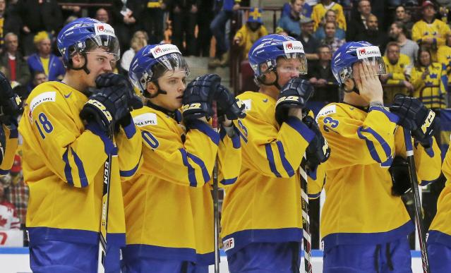 Sweden's (L-R) Andre Burakowsky, Lukas Bengtsson, Gustav Olofsson, and Nick Sorenson react to losing to Finland in overtime of their IIHF World Junior Championship gold medal ice hockey game in Malmo, Sweden, January 5, 2014. REUTERS/Alexander Demianchuk (SWEDEN - Tags: SPORT ICE HOCKEY)
