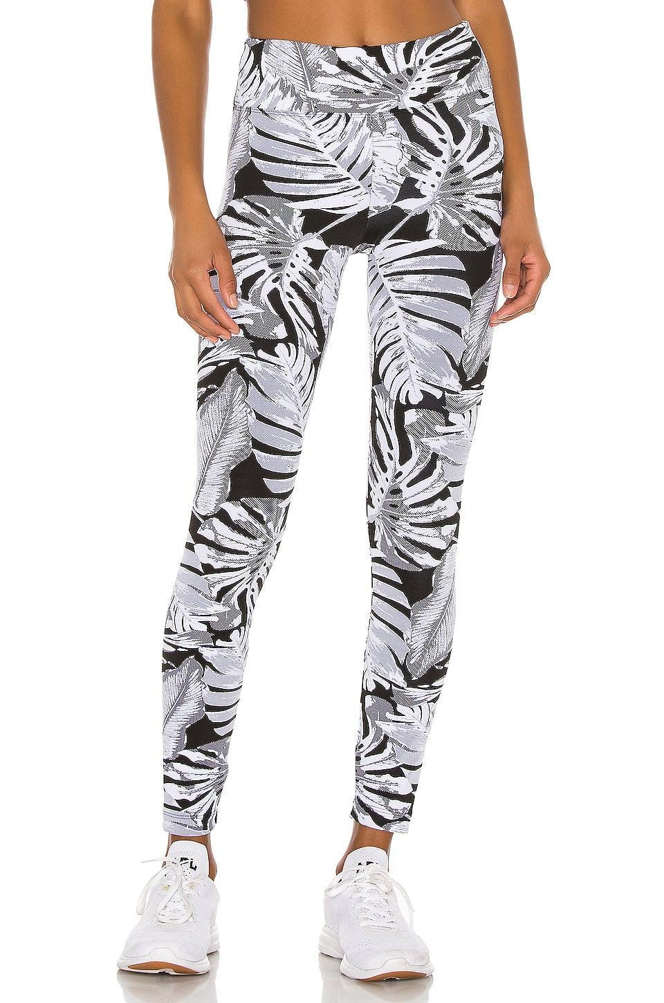 "<p><a href=""https://www.popsugar.com/buy/Koral-Drive-Paradise-High-Rise-Legging-587695?p_name=Koral%20Drive%20Paradise%20High%20Rise%20Legging&retailer=revolve.com&pid=587695&price=82&evar1=fit%3Aus&evar9=47603352&evar98=https%3A%2F%2Fwww.popsugar.com%2Fphoto-gallery%2F47603352%2Fimage%2F47603354%2FKoral-Drive-Paradise-High-Rise-Legging&list1=shopping%2Cworkout%20clothes%2Csale%2Cproducts%20under%20%24100%2Csale%20shopping&prop13=api&pdata=1"" class=""link rapid-noclick-resp"" rel=""nofollow noopener"" target=""_blank"" data-ylk=""slk:Koral Drive Paradise High Rise Legging"">Koral Drive Paradise High Rise Legging</a> ($82, originally $125)</p>"