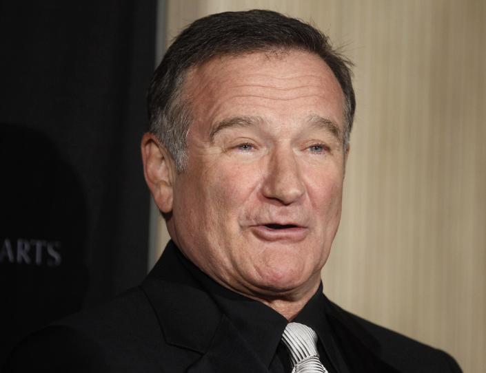 Actor Robin Williams poses as he arrives at the British Academy of Film and Television Arts Los Angeles Britannia Awards in Beverly Hills, California in this November 30, 2011 file photo. Actor-comedian Robin Williams was found dead on August 11, 2014 at his home in Northern California from an apparent suicide, Marin County Sheriff's Office said. He was 63. REUTERS/Fred Prouser/Files (UNITED STATES - Tags: ENTERTAINMENT OBITUARY)