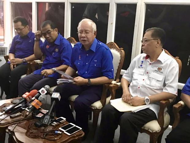 Prime Minister Datuk Seri Najib Tun Razak (third from left) speaks to reporters after a community event in Muar on February 9, 2018. — Picture by Ben Tan