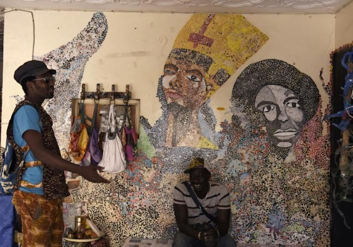 Mamadou Boye Diallo((L), the founder of the Yataal Art fair, is also a local guide (AFP Photo/SEYLLOU)