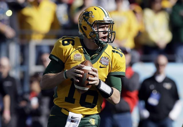 North Dakota State quarterback Brock Jensen drops back to pass in the first half of the FCS championship NCAA college football game against Towson, Saturday, Jan. 4, 2014, in Frisco, Texas. (AP Photo/Tony Gutierrez)