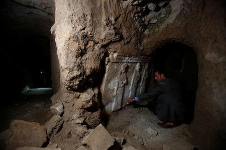 Archaeologist Musab Mohammed Jassim shows artefacts and archaeological pieces in a tunnel network running under the Mosque of Prophet Jonah, Nabi Yunus in Arabic, in eastern Mosul