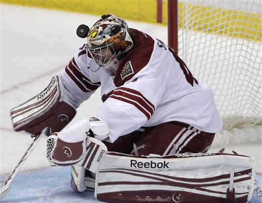 Phoenix Coyotes goalie Mike Smith is hit by a puck in the third period of an NHL hockey game in Anaheim, Calif., Wednesday, Jan. 18, 2012. The Ducks won 6-2. (AP Photo/Jae C. Hong)