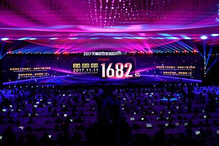 A screen shows the value of goods being transacted at Alibaba Group's 11.11 Singles' Day global shopping festival in Shanghai, China, November 12, 2017. REUTERS/Aly Song