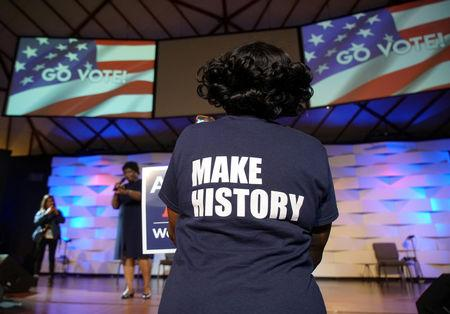 "A Stacey Abrams supporter wears a ""Make History"" shirt while listening to Democratic gubernatorial candidate for Georgia, Stacey Abrams, speak ahead of the midterm elections in Conyers, Georgia, U.S., October 26, 2018. REUTERS/Lawrence Bryant"