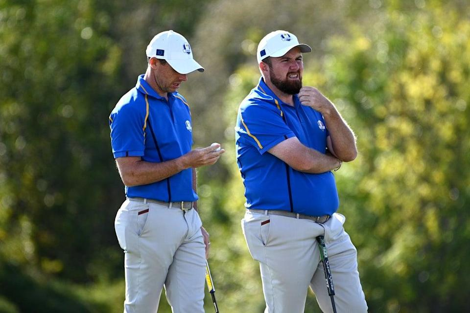 Rory McIlroy (left) and Shane Lowry on the 10th hole during day two of the Ryder Cup (Anthony Behar/PA) (PA Wire)