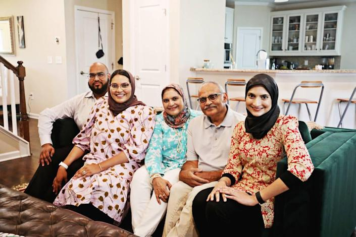 Durham commissioner Nida Allam, second from left, has had the full support of her family after a miscarriage. Allam is pictured here with her husband, Towqir Aziz, left, her parents Iffat and Abdul Allam, and sister, Arsheen Allam, far right, at her Durham home on Friday, Aug. 27, 2021. Allam is sharing her personal story about a recent miscarriage to bring about more awareness and support.