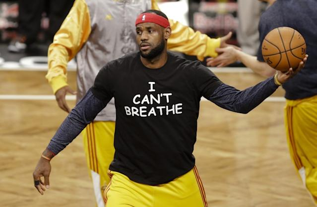 "LeBron James wears a T-shirt with the words ""I can't breathe"" during warmups for a game between the Cleveland Cavaliers and Brooklyn Nets on Dec. 8, 2014. <span class=""copyright"">(Frank Franklin II / Associated Press)</span>"