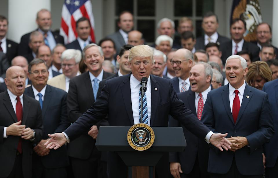 President Trump gathers with Vice President Mike Pence and Congressional Republicans after the House of Representatives approved the American Healthcare Act, to repeal major parts of Obamacare and replace it with the Republican healthcare plan, in Washington, U.S., May 4, 2017. REUTERS/Carlos Barria