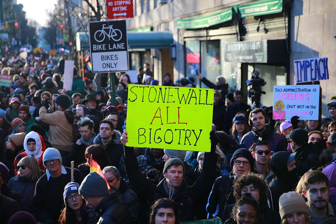 <p>People protest in front of the Stonewall Inn in solidarity with immigrants, asylum seekers, refugees, and the LGBT community, Feb. 4, 2017 in New York. (Photo: Gordon Donovan/Yahoo News) </p>