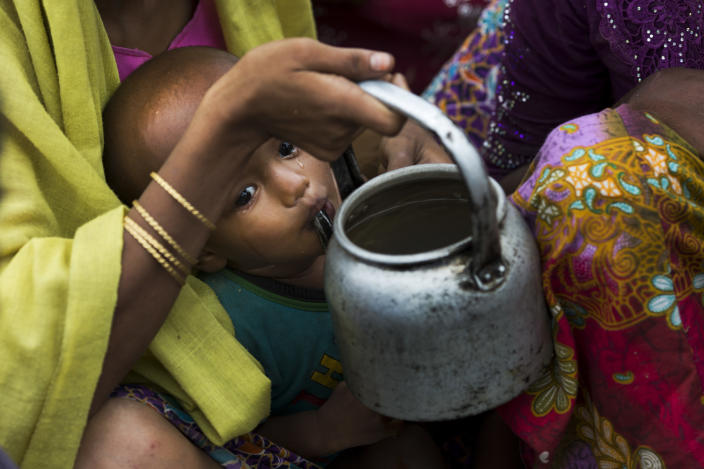 Tears roll down the cheeks of a child while drinking water from a kettle, as Rohingya Muslims who have fled persecution in Myanmar wait along the border for permission to move farther toward refugee camps near Palong Khali, Bangladesh, Nov. 2, 2017. (Photo: Bernat Armangue/AP)