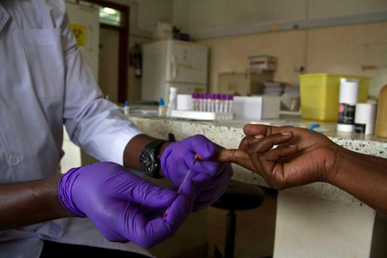 A record 23.3 million people with HIV/AIDS have access to some antiretroviral therapy (ART) (AFP Photo/ISAAC KASAMANI)