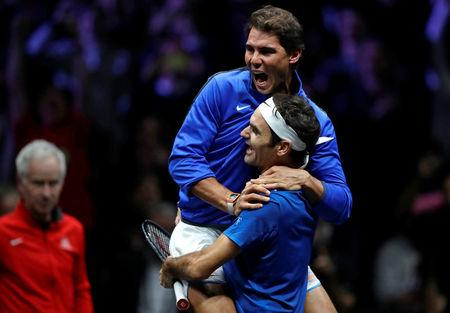 Tennis - Laver Cup - 3rd Day - Prague, Czech Republic - September 24, 2017 - Roger Federer and Rafael Nadal of team Europe celebrate after winning the match.   REUTERS/David W Cerny